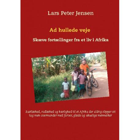 Ad hullede veje: Skæve fortællinger fra et liv i Afrika